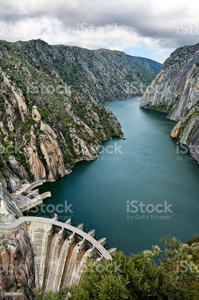 Blue lake surrounded by cliffs and mountains stock photo