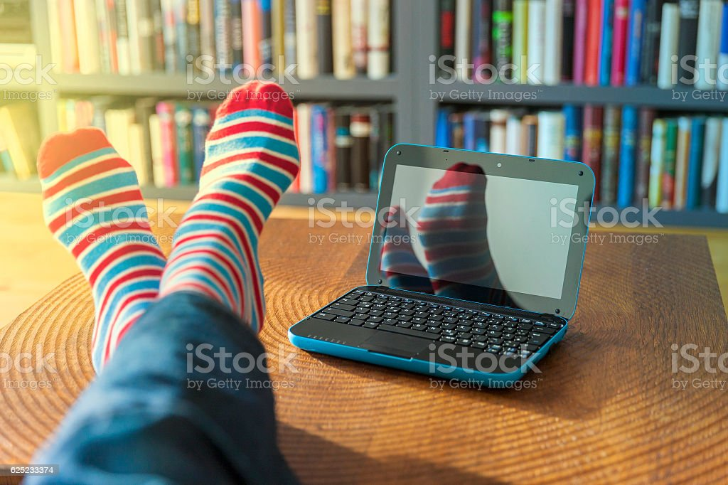 Blue laptop and striped socks stock photo