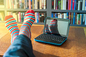 Blue laptop and striped socks