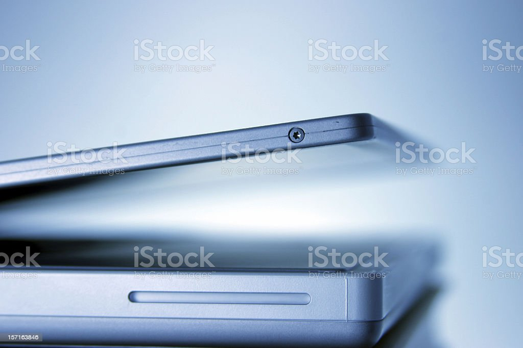 Blue laptop nearly closed or the moment of opening royalty-free stock photo