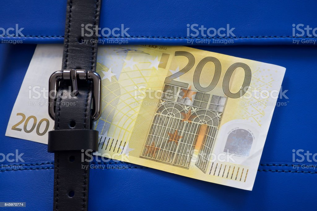 blue leather bag stitching with black buckle and money stock photo