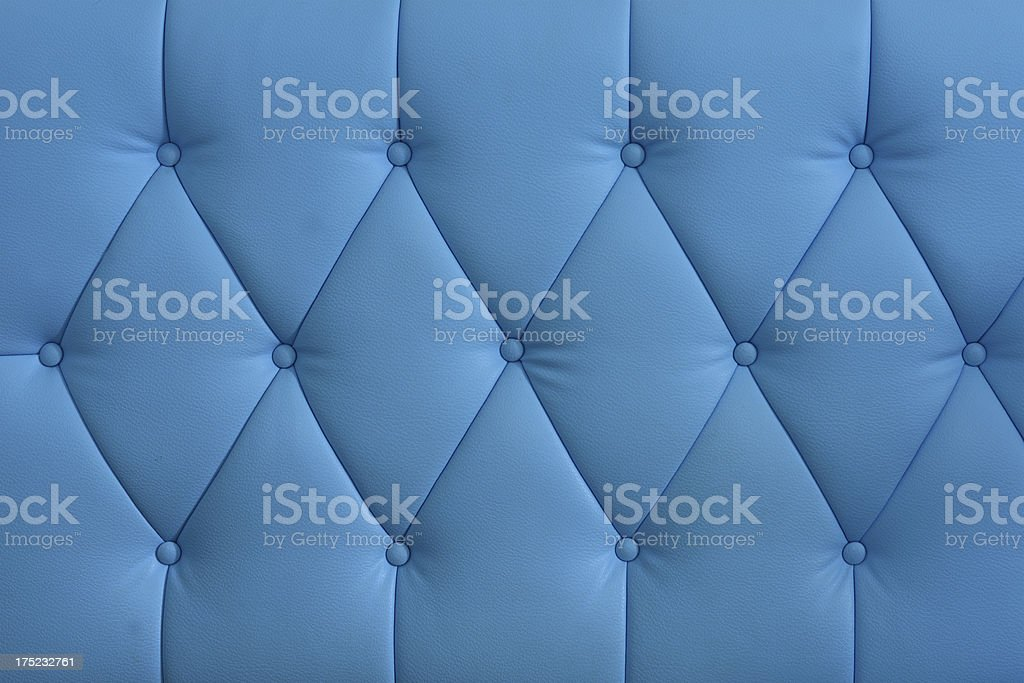 Blue leather couch textured royalty-free stock photo