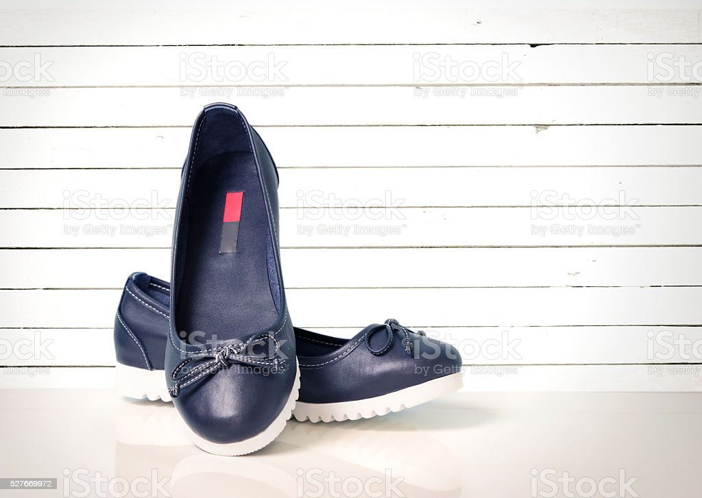 Blue leather flat shoes modern design on white background. stock photo