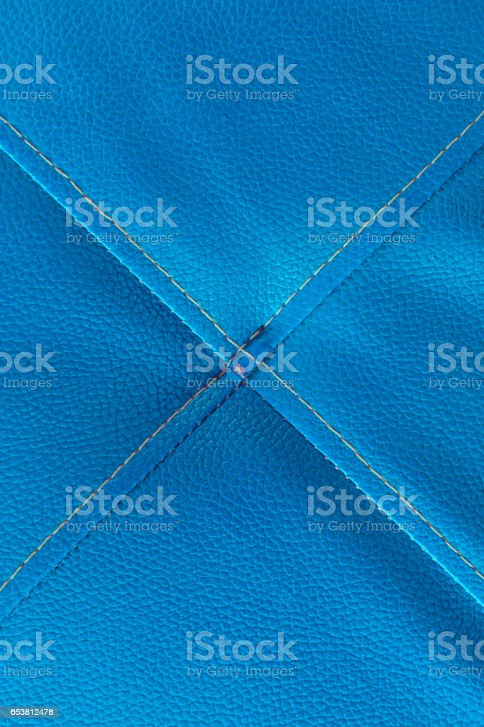 Blue leather with stitch texture and crosswise  symbol stock photo
