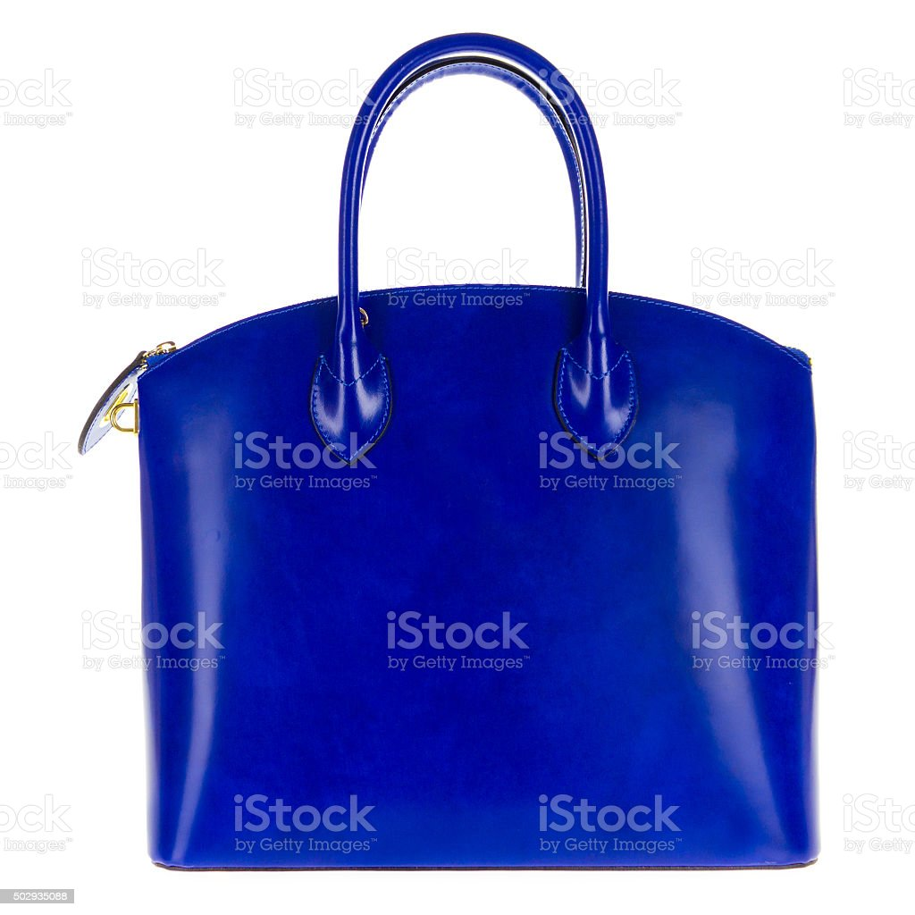 Blue leather women's tote handbag on white background stock photo