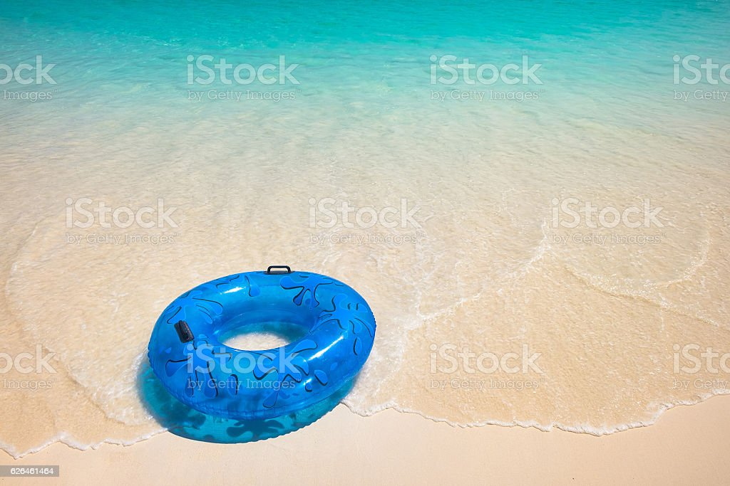 Blue Life Buoy on the White Beach stock photo