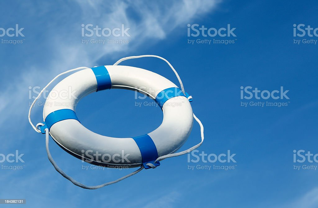 Blue life buoy thrown into air royalty-free stock photo