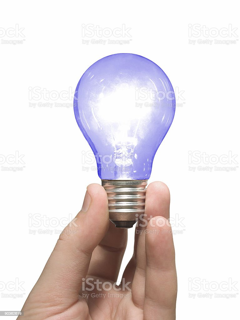 Blue light bulb in hand royalty-free stock photo