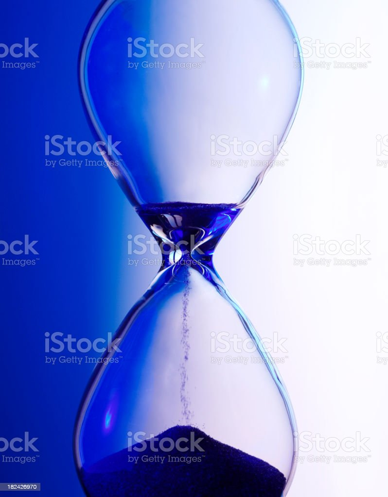 Blue light on a Hourglass royalty-free stock photo