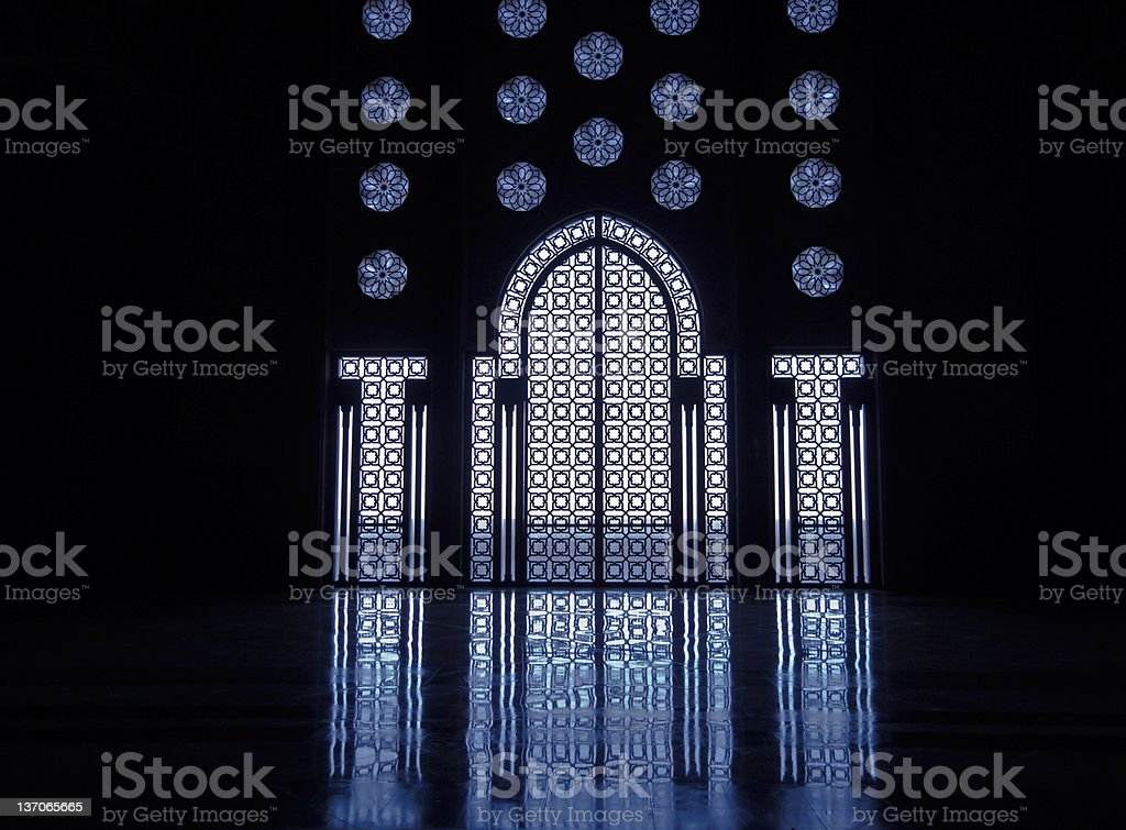 Blue light reflects thru stained glass windows of doorway royalty-free stock photo