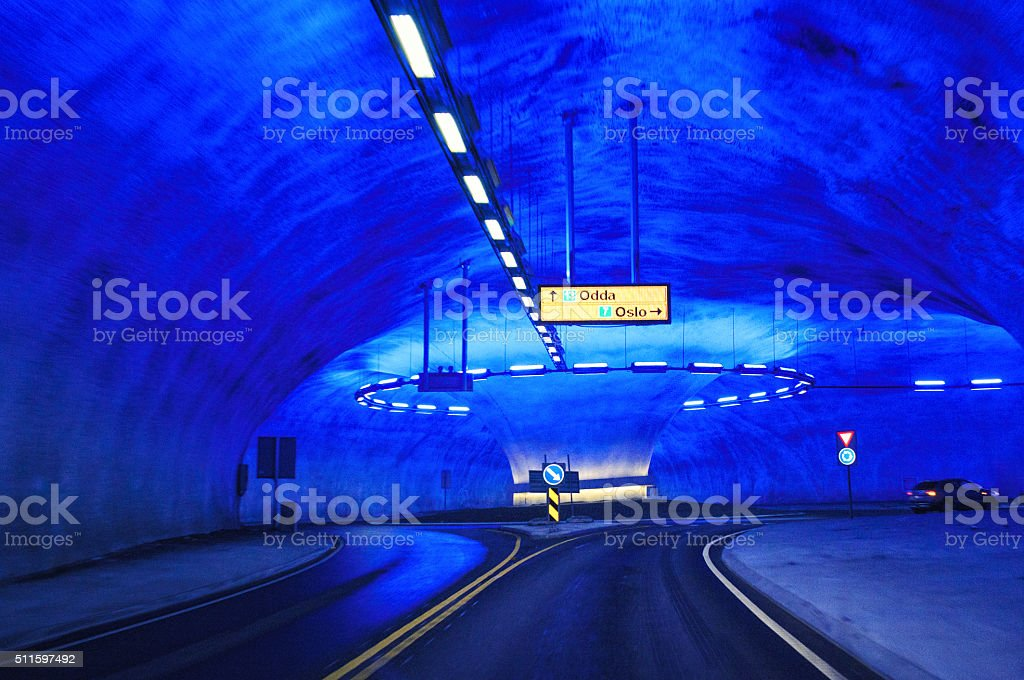 Blue lighted tunnel with traffic circle stock photo