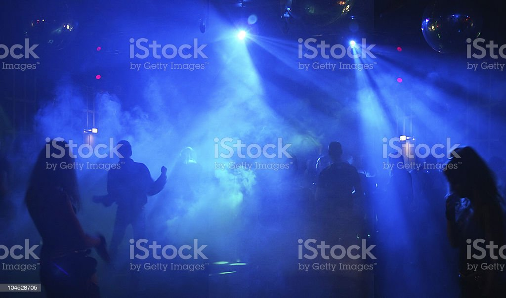 Blue lights in a nightclub where teenagers are dancing royalty-free stock photo