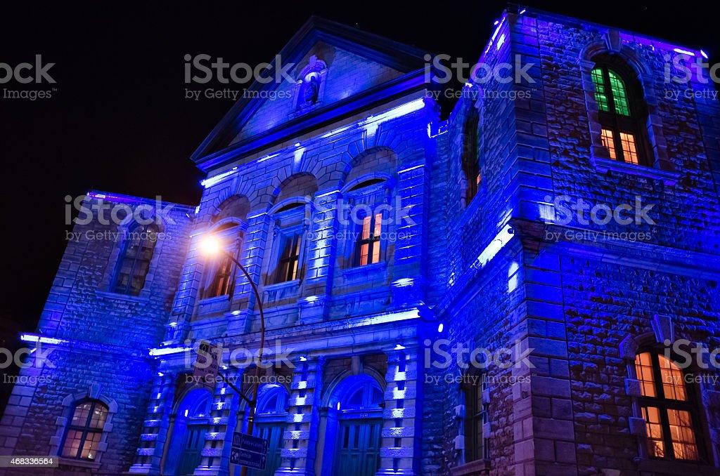 Blue lights on church facade stock photo