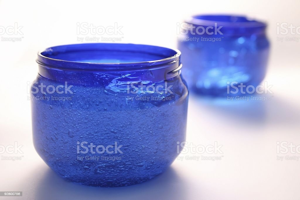 Blue liquid containers royalty-free stock photo