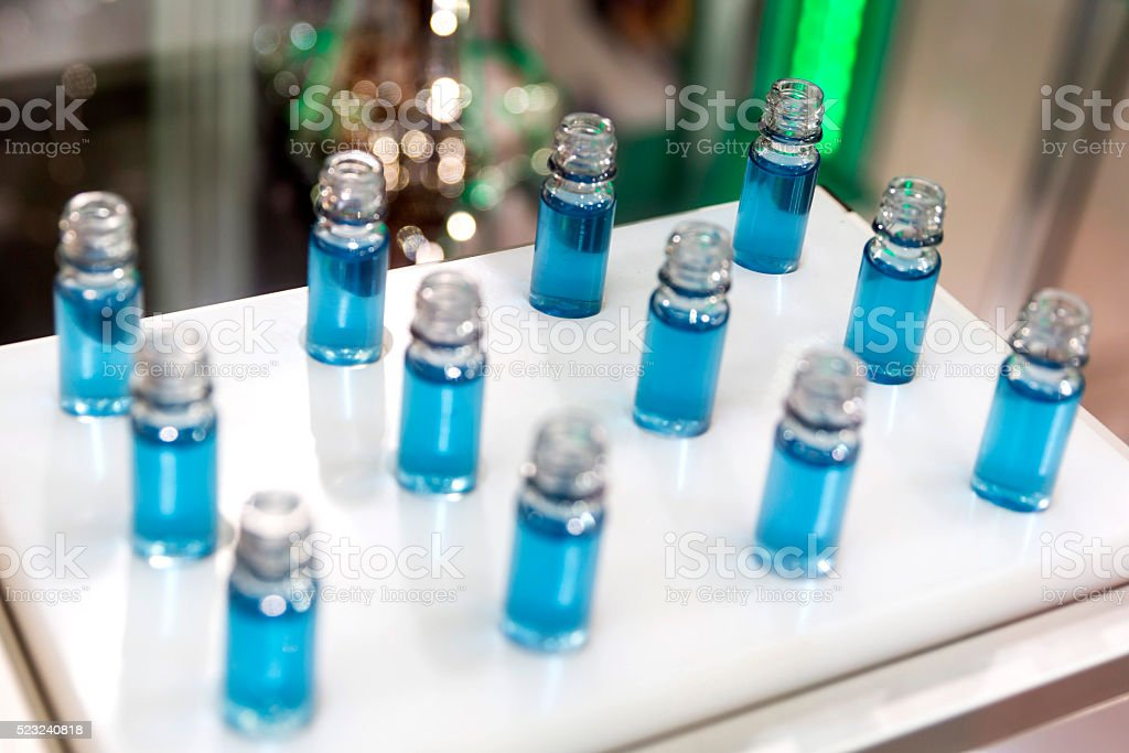 Blue liquid in laboratory test tubes stock photo