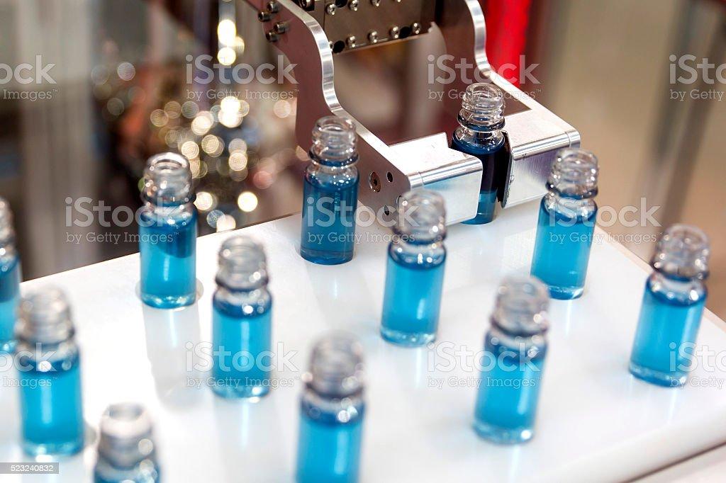 Blue liquid in laboratory test tubes stock photo