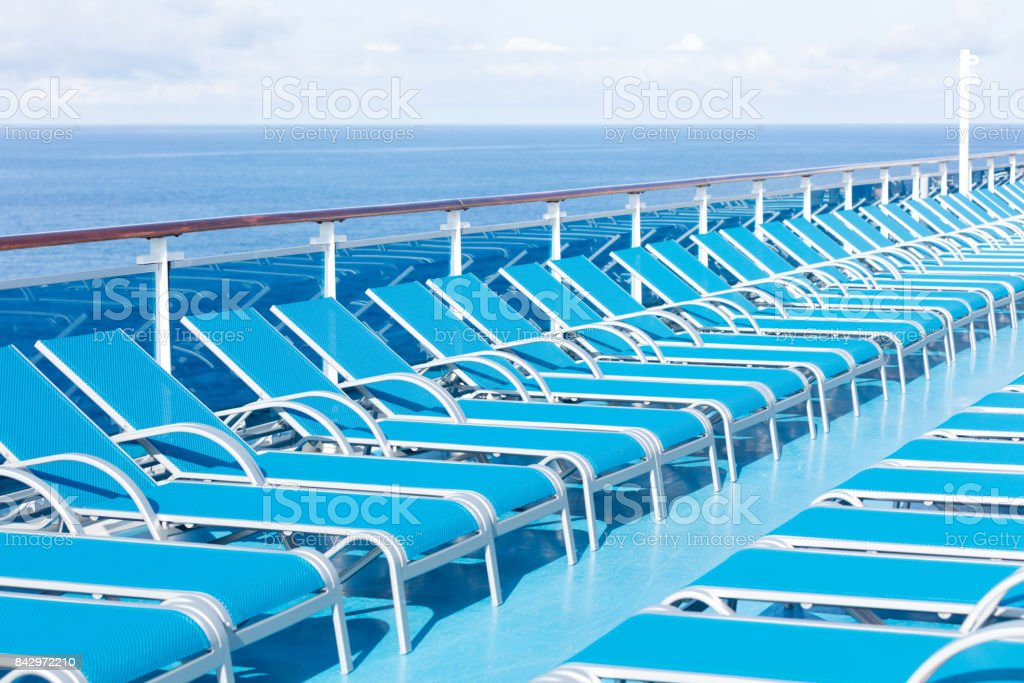 blue loungers on the deck stock photo