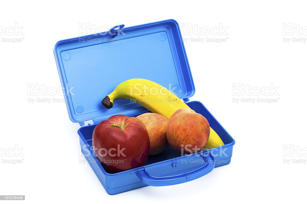 Blue lunch box with banana, apple and peaches royalty-free stock photo