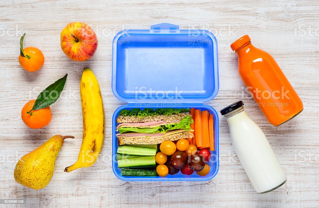 Blue Lunch Box with Fruits and Milk stock photo