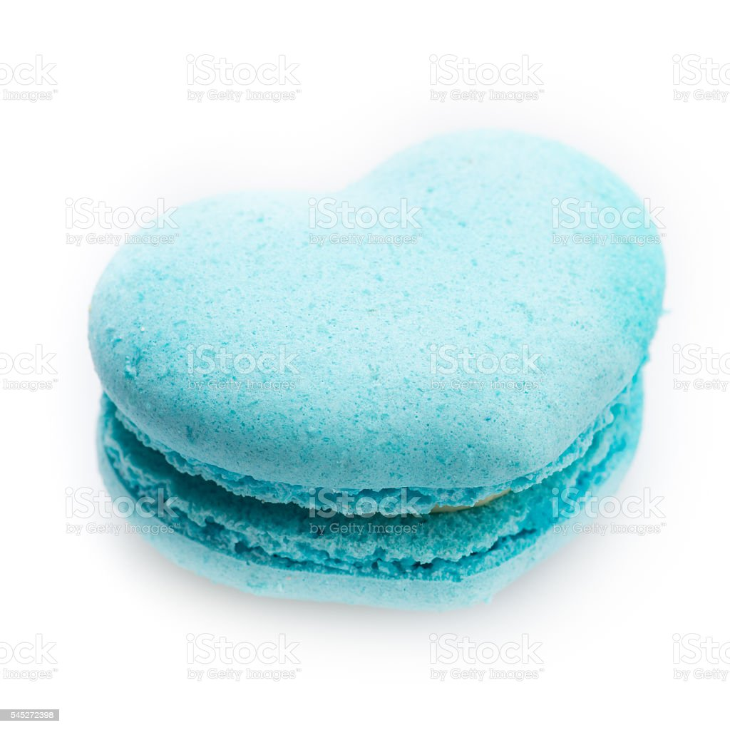 blue macaron in heart shape on white background stock photo