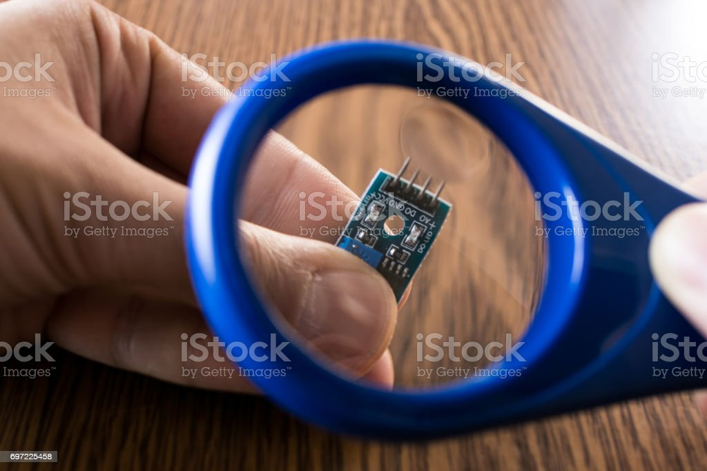 Blue Magnifying glass stock photo