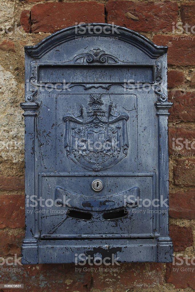 Blue mailbox on a brick wall royalty-free stock photo
