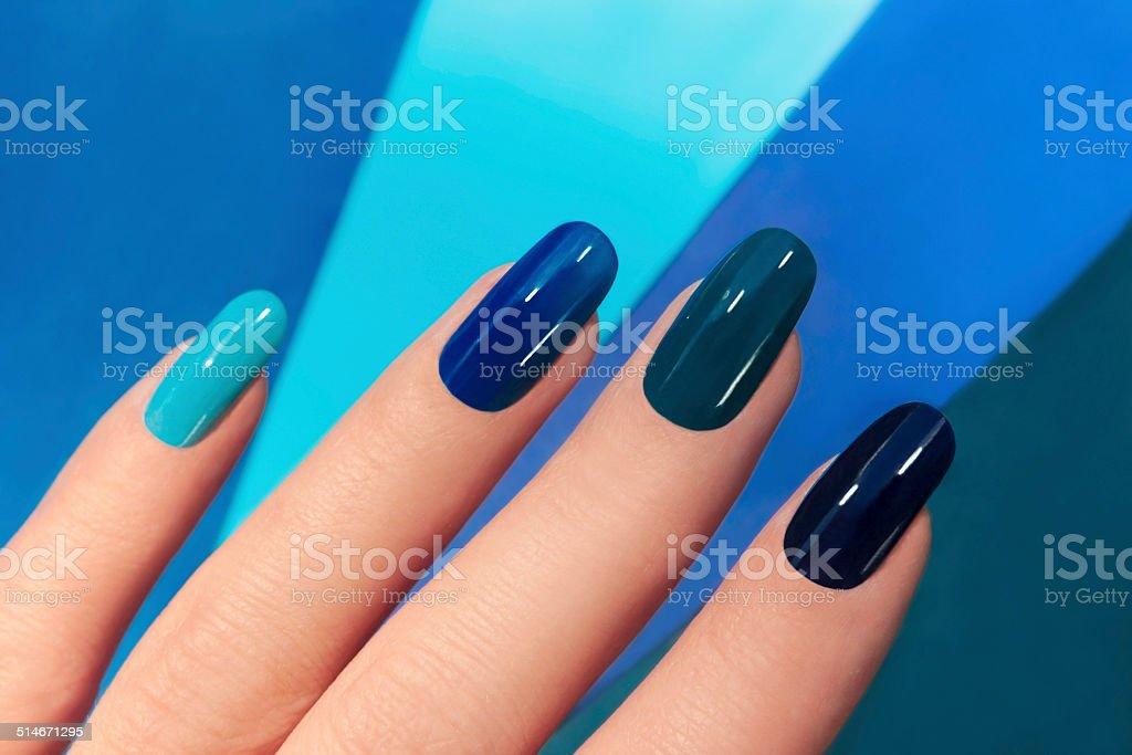 Blue manicure. stock photo