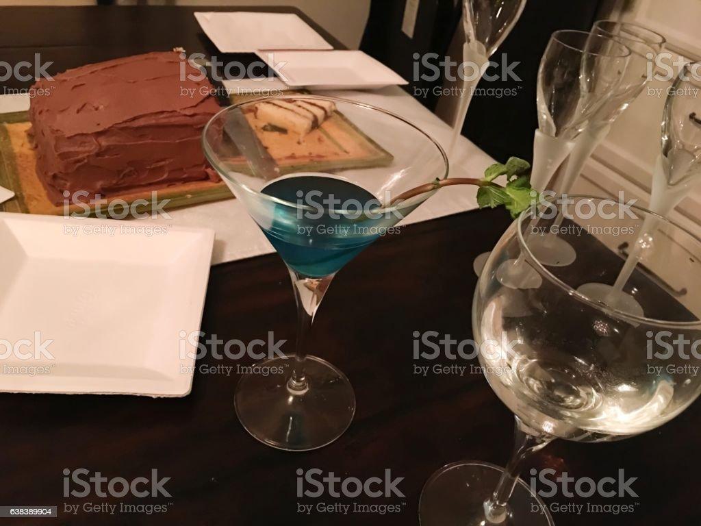 Blue Martini and Chocolate cake stock photo