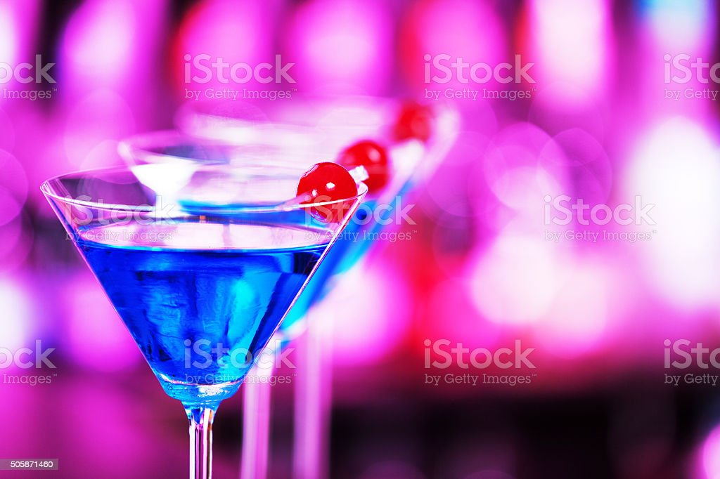 Blue Martini cocktail on a bar stock photo