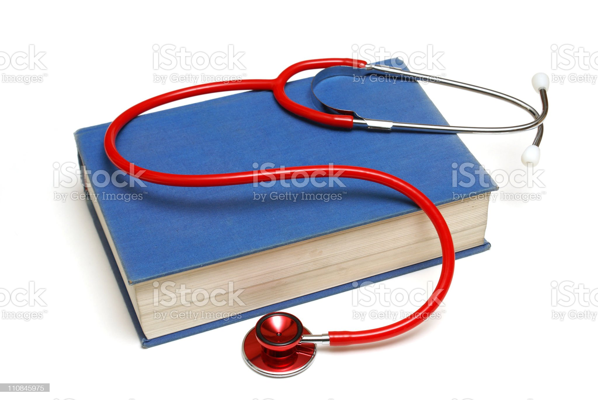 Blue medical book and a red stethoscope royalty-free stock photo