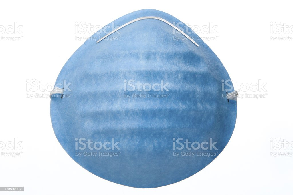Blue medical mask against white background stock photo