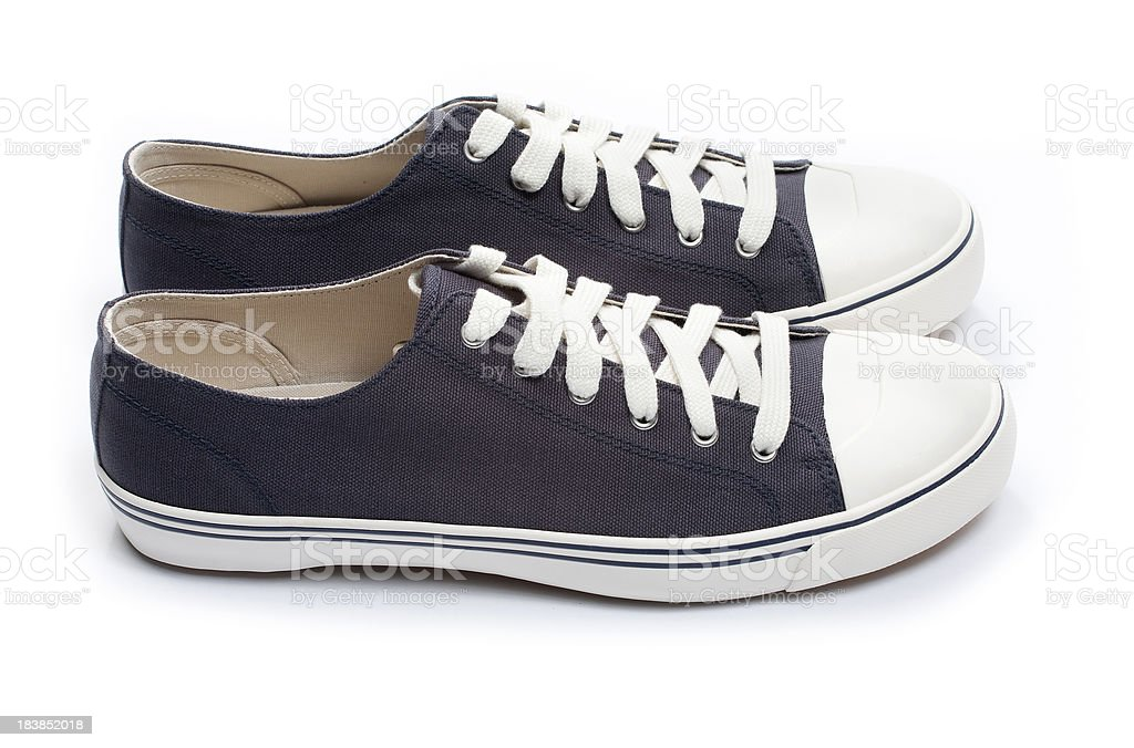 Blue men's sneakers isolated on white stock photo