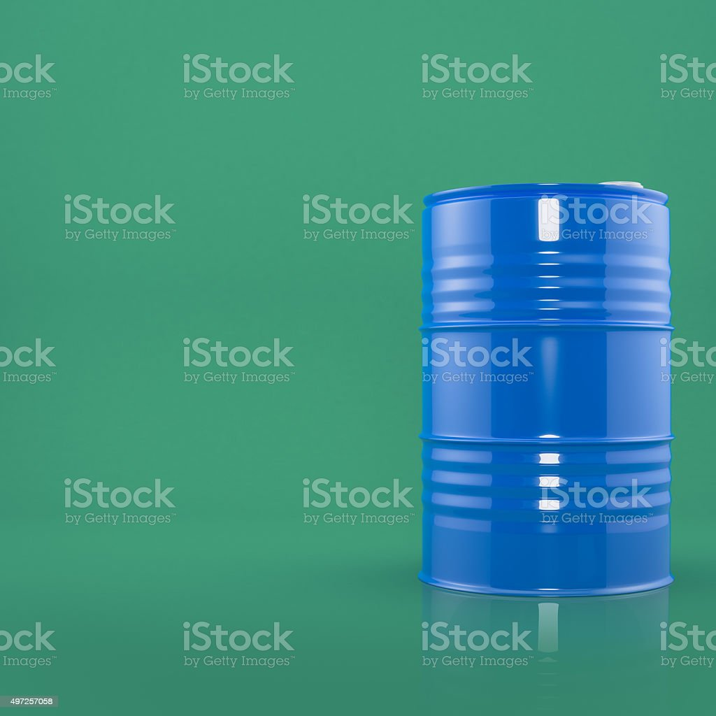 Blue metal barrel on green color background stock photo
