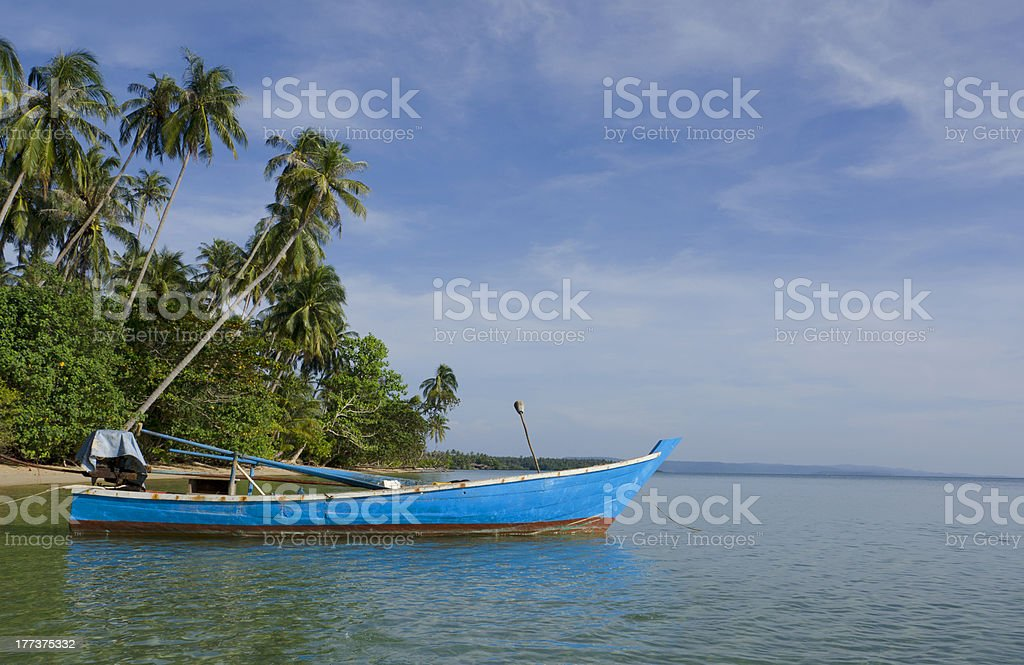 Blue Metal Boat In The Sea royalty-free stock photo