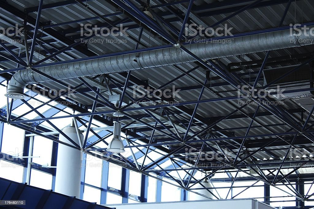 Blue metalic beams of airport roof stock photo