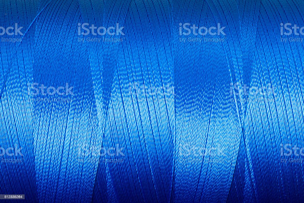 blue metallic thread stock photo