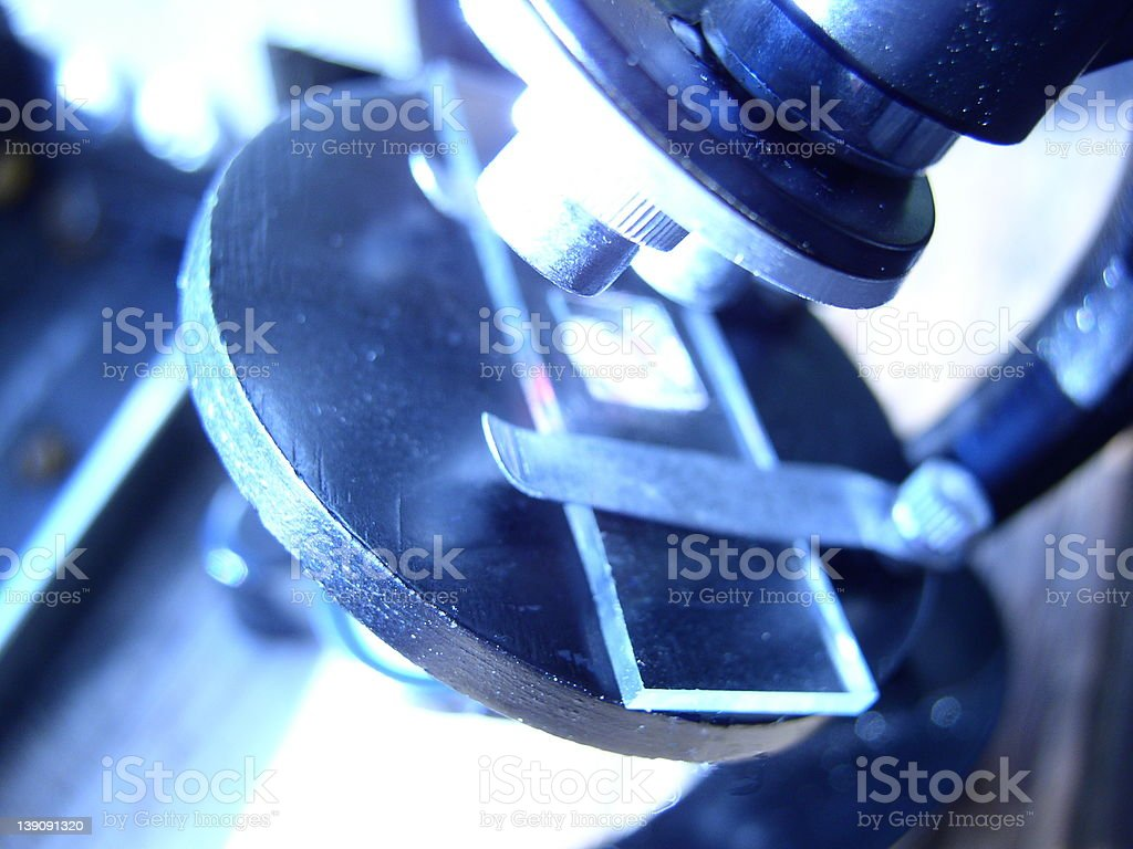 Blue microscope stage with slide - RESEARCH royalty-free stock photo