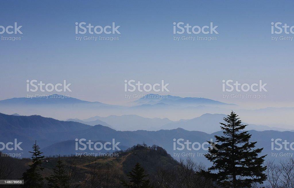 Blue Misty Mountain Range in Japan stock photo
