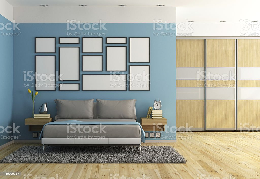 Blue modern bedroom with double bed and wardrobe royalty-free stock photo