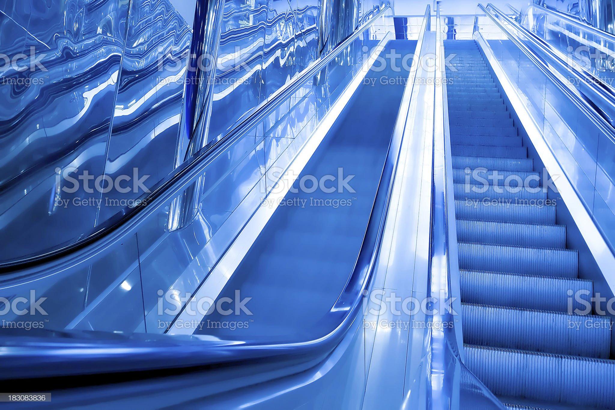 blue modern escalator in business center royalty-free stock photo