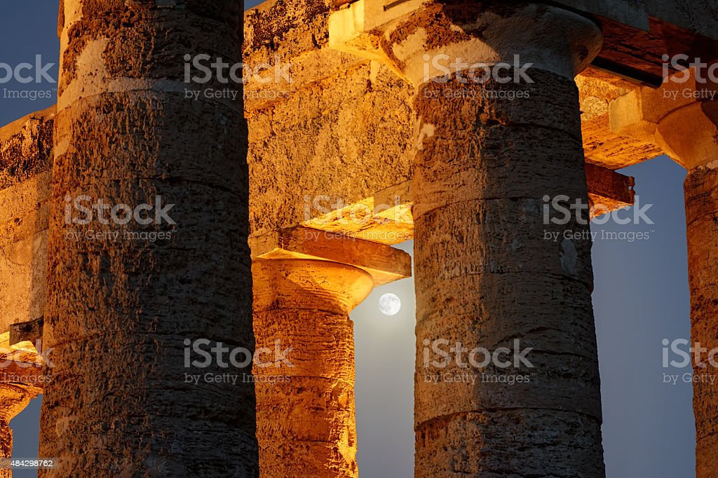 Blue Moon Among The Columns of Segesta Temple stock photo