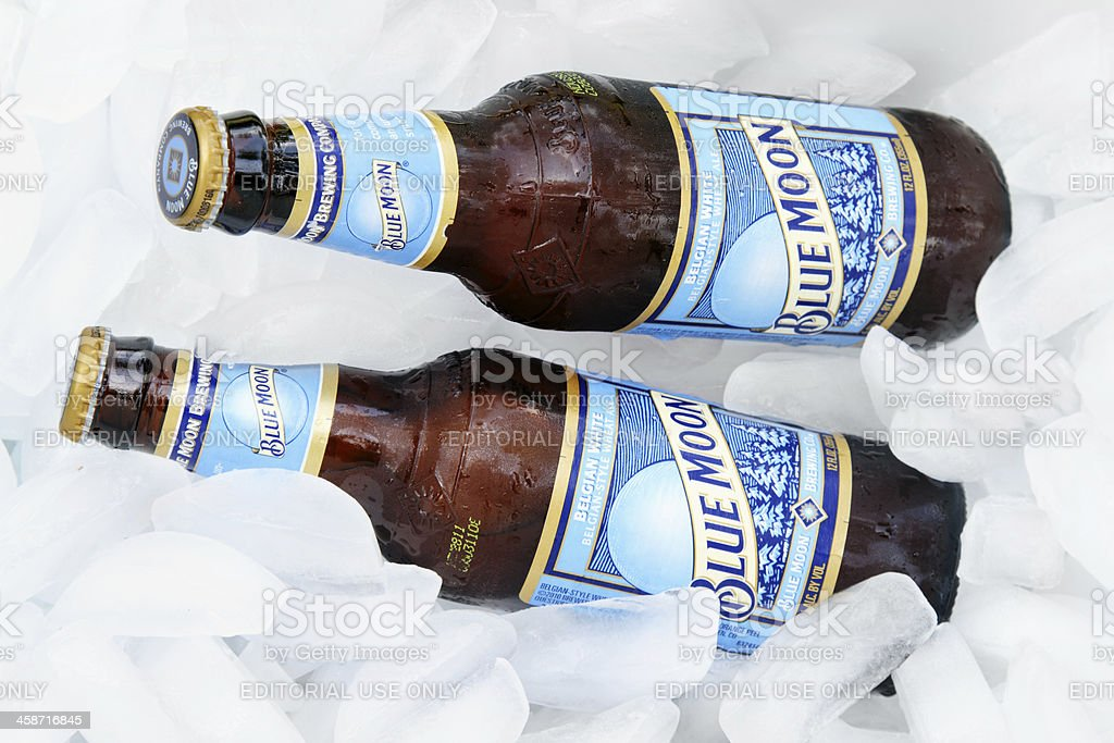 Blue Moon beer on ice stock photo