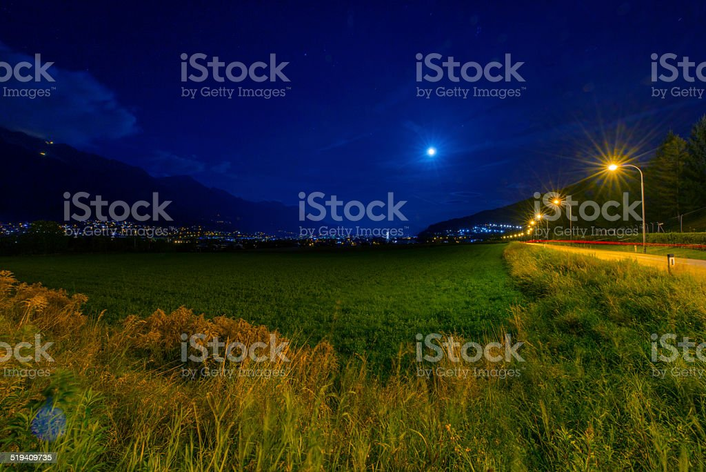 Blue Moon over City at Night stock photo