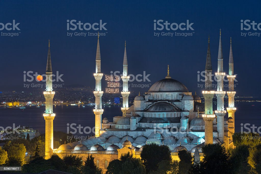 Blue Mosque and the moon stock photo