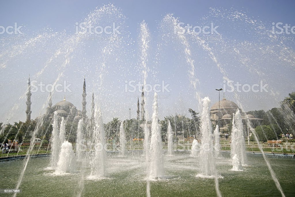 Blue Mosque through fountains royalty-free stock photo