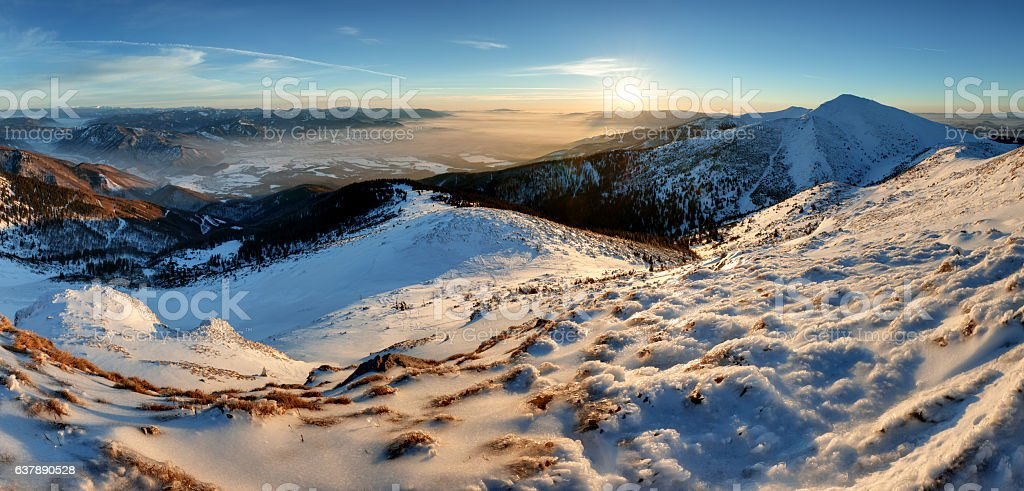 Blue mountain winter panorama at sunset Slovakia, peak Chleb stock photo
