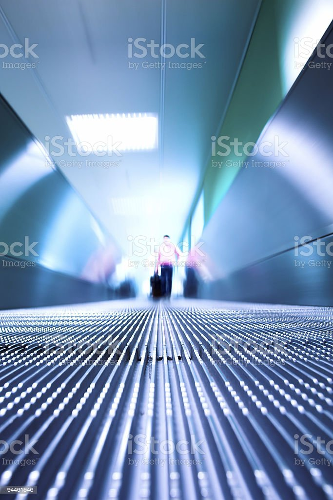 Blue moving escalator in the office hall royalty-free stock photo