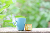blue mug and crackers flower on wood table