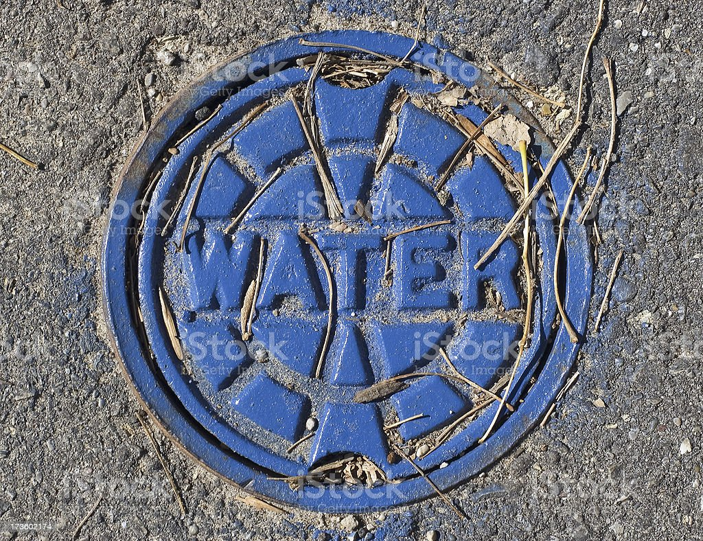Blue Municipal Water Main Cover stock photo