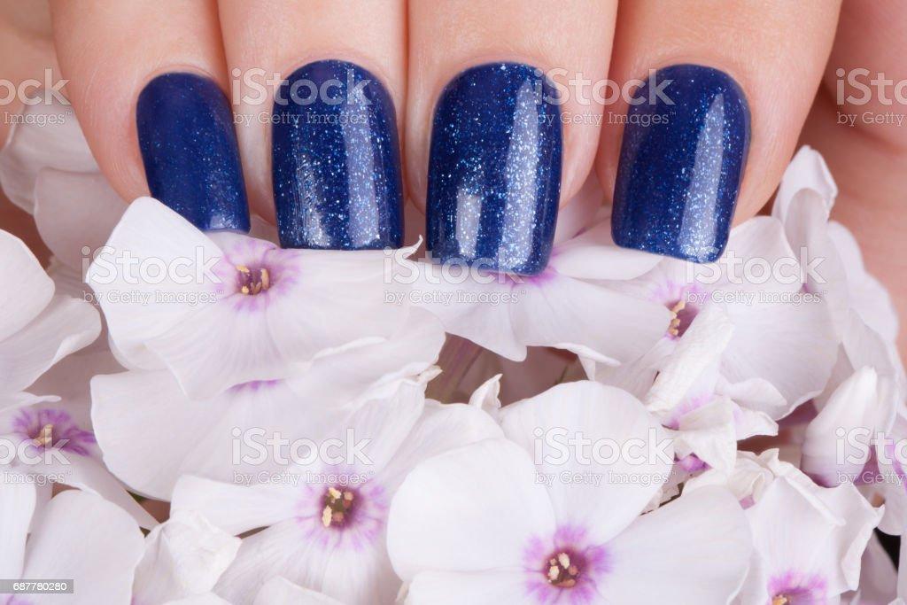 Blue nail polish. stock photo